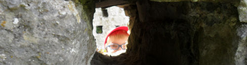 Boy looking through a hole