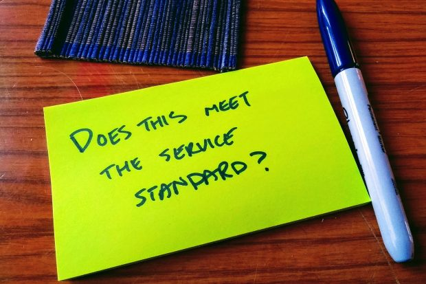 Post-it note with the following question written, does this meet the service standard?
