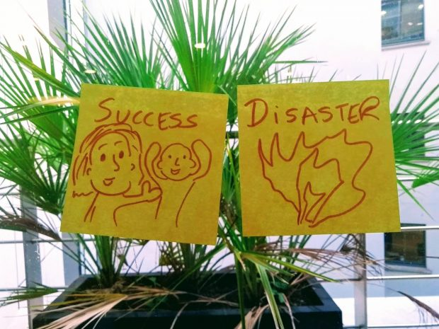 success versus disaster written on post-its